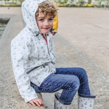 Childrens white raincoat with navy blue anchor motif