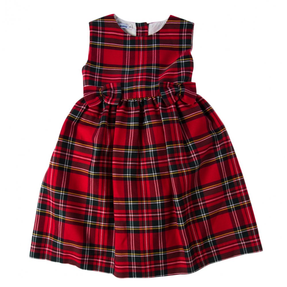 Child's Girl's Tartan Pinafore Dress made in Scotland in authentic custom or in-stock tartans. Beautiful tartan pinafore with button fastenings on the shoulder and a bias cut skirt. The simple shape flatters all ages and little girl's just love the pocket on the skirt. Complete the outfit with matching tartan pumps Brand: Scotlandshop.